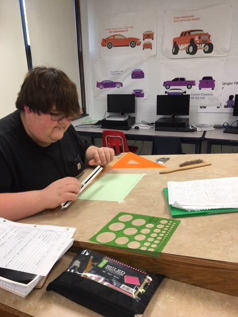 Student reviewing his drafting project.