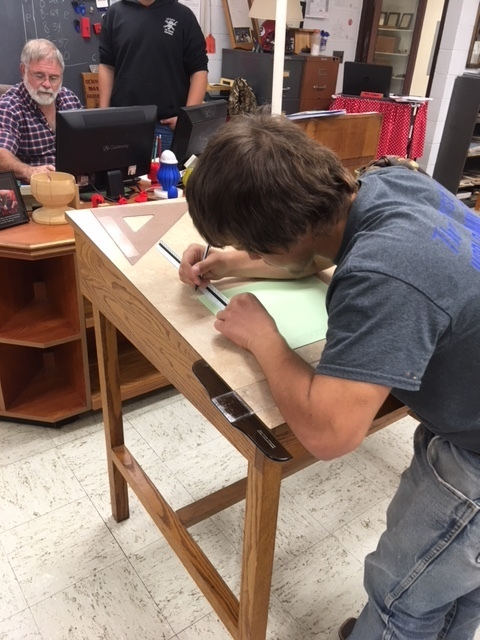 Student working on drafting skills.