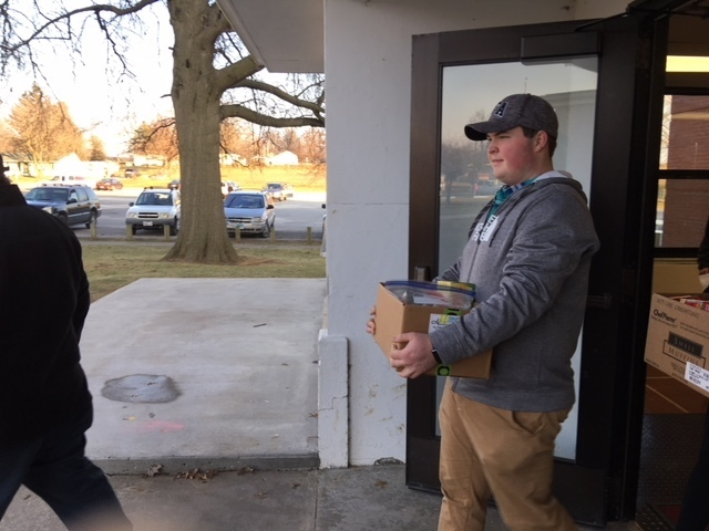 Wes Bradshaw hauling out food.